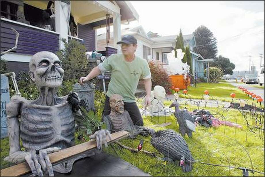 Rick Kimberlin sets up his ghoulish displays outside his home. But his real holiday love is Christmas, when he turns his house and yard into a winter wonderland. Photo: Karen Ducey/Seattle Post-Intelligencer