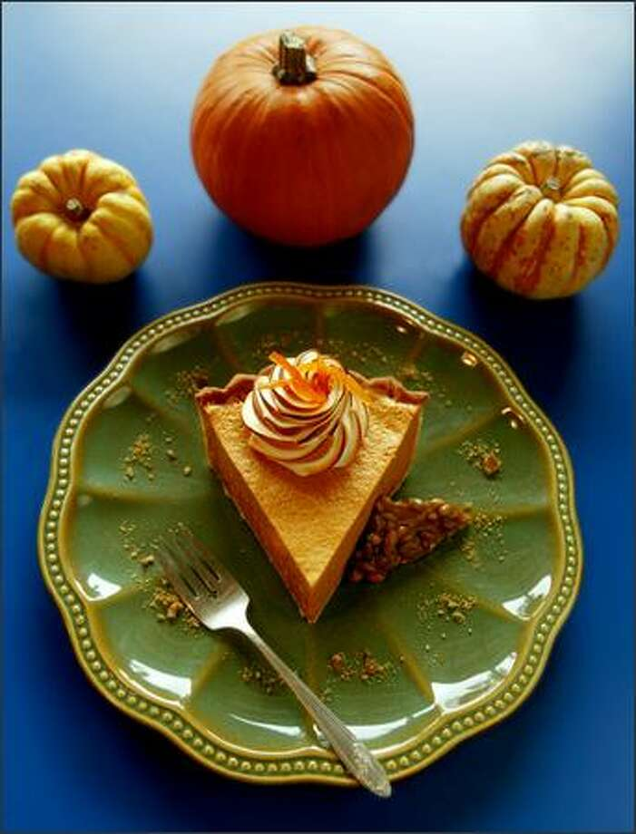 For a lighter holiday dessert, a meringue-topped Pumpkin Chiffon Pie and a side of Pumpkin-Seed Brittle fills the bill. Photo: SCOTT EKLUND/P-I