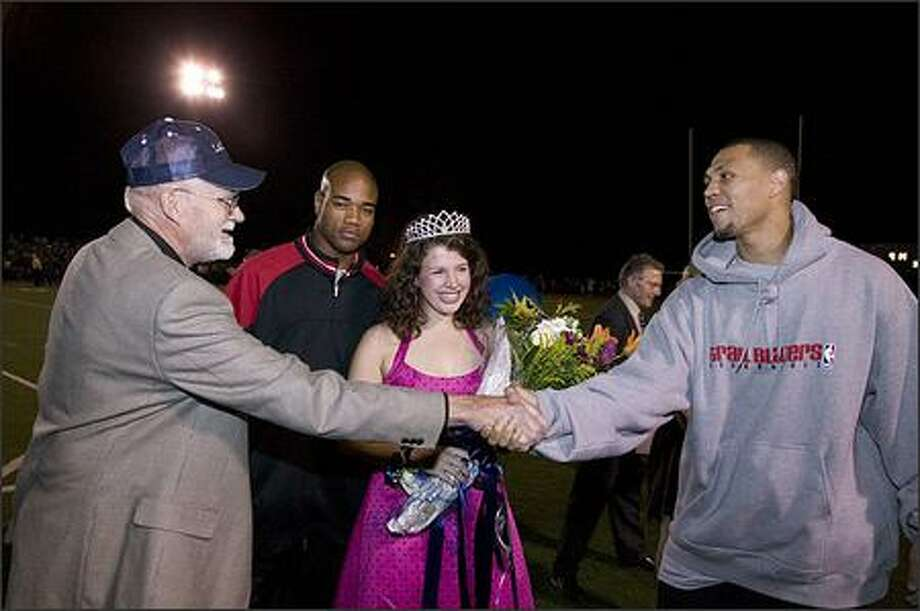 Trail Blazers rookie Brandon Roy, the former University of Washington All-American, mingles with fans at a high school football game in the Portland area. Photo: Sam Forencich/Portland Trail Blazers