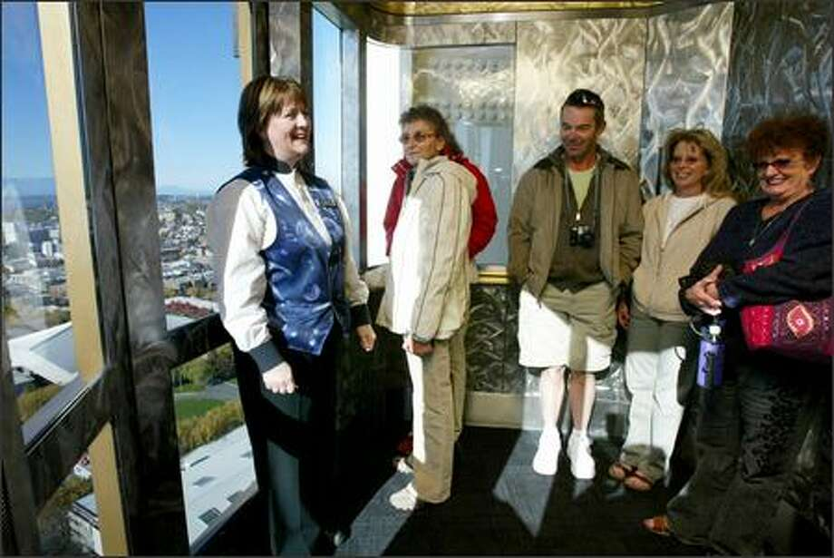 Elevator operator Jenny Dibley will celebrate 30 years at the Space Needle today by doing what she does best: going up and down and entertaining visitors along the way. Photo: Paul Joseph Brown/Seattle Post-Intelligencer