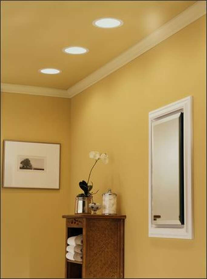 A series of three combination recessed light/vent fans installed in one end of a large bathroom. Photo: BROAN PHOTO