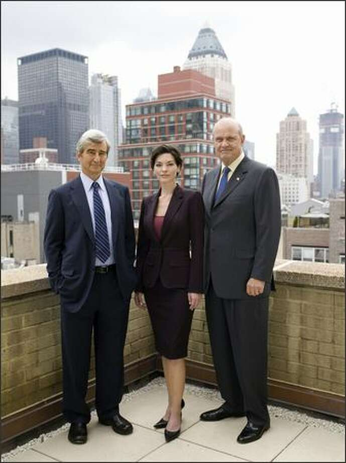 "The fatigue of ""Law & Order"" is reflected in the tired faces of Sam Waterston, left, and Fred Dalton Thompson, right, who both look las if they could use a nap, compared to Alana De La Garza, center. Photo: / NBC"