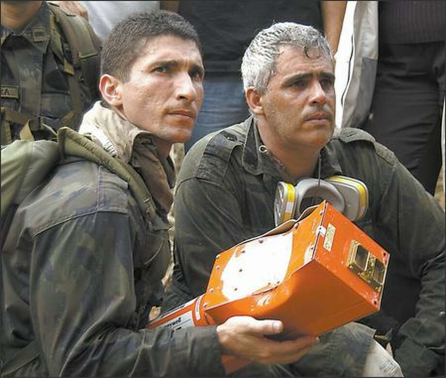 In this Oct. 2 picture released by the Brazilian air force, airmen hold the so-called black box of the Gol airlines Boeing 737-800 that crashed in Serra do Cachimbo on Sept. 29, killing 154 people. Photo: / Associated Press