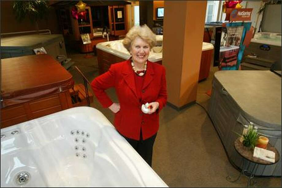Olympic Hot Tub co-owner Alice Cunningham stands in her Seattle showroom on Thursday where customers are invited to take a dip. Photo: Paul Joseph Brown/Seattle Post-Intelligencer