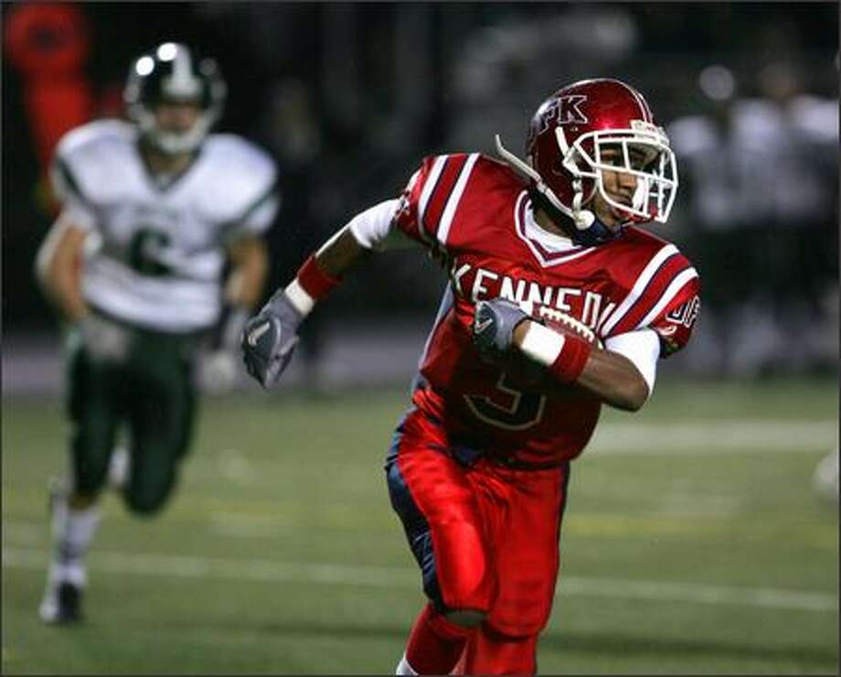 Kennedy's Nolan Washington runs in open field Friday night against Skyline. Washington had two touchdowns in the game. Photo: Kevin P. Casey/Special To The Seattle Post-Intelligencer