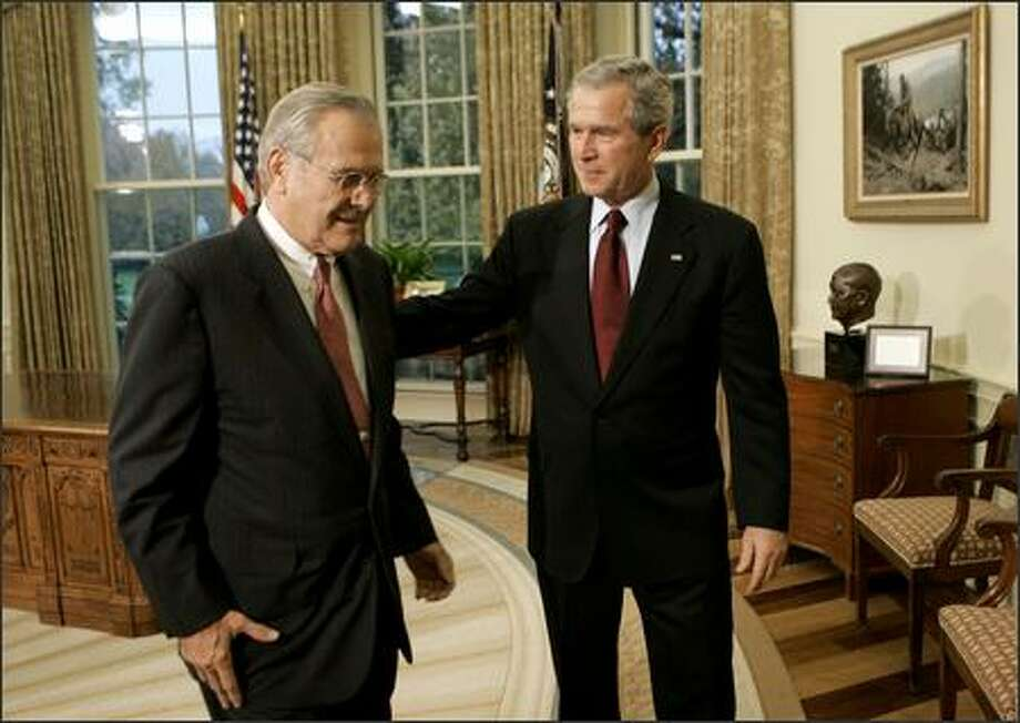 President Bush, right, walks out of the Oval Office of the White House in Washington with outgoing Defense Secretary Donald H. Rumsfeld after announcing that former CIA Director Robert Gates was nominated to replace Rumsfeld. Photo: / Associated Press