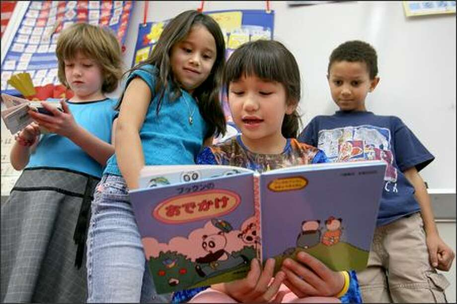 John Stanford International School first-grader Chiyo Aoki-Kramer reads a Japanese book to classmates, back from left, Suzanne Porteous, Mirabai Chavez-Lewis and Ethan Major. Photo: Scott Eklund/Seattle Post-Intelligencer