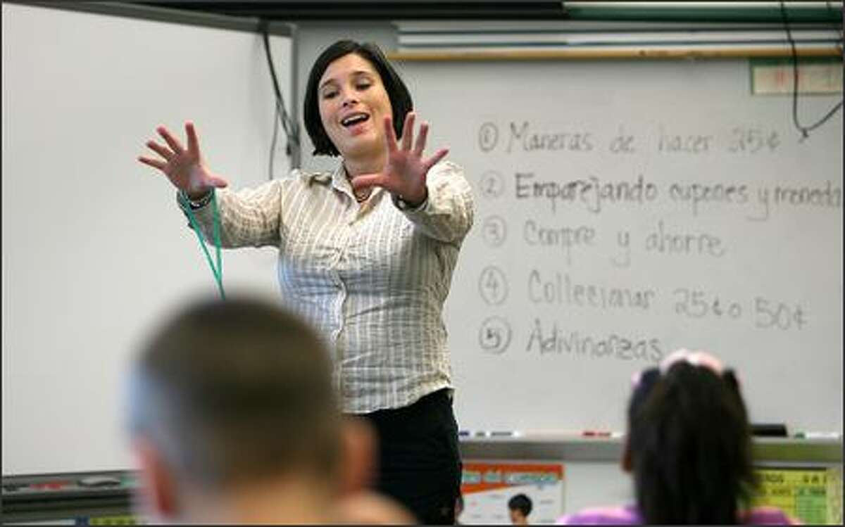 Teacher Sabrina Kovacs-Storlie teaches Spanish Thursday to her second-grade class at John Stanford International School. Students also learn Japanese.