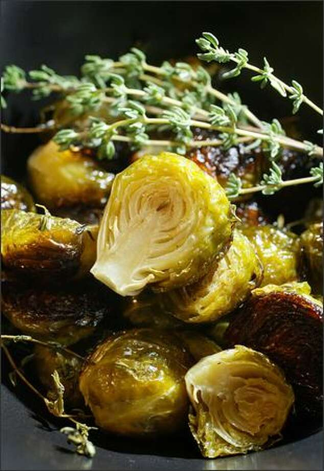Thyme-Roasted Brussels Sprouts caramelize as they roast in the oven for a pleasant sweetness. Photo: DAN DELONG/P-I
