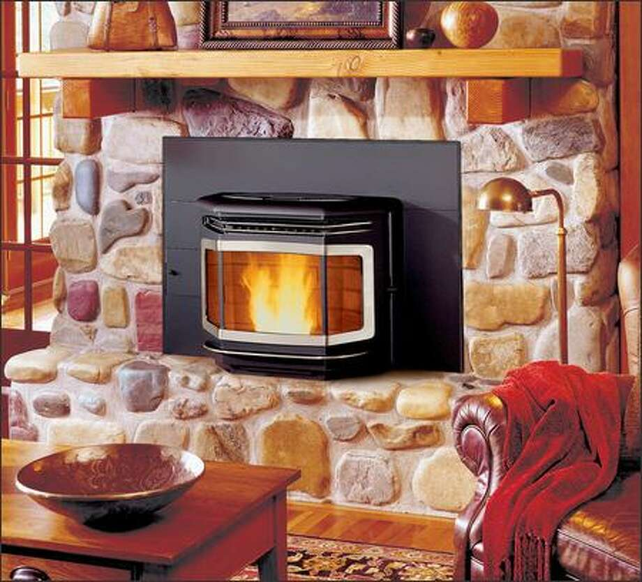 This wood pellet fireplace insert will burn a mixture of up to 50 percent corn. It is EPA certified and produces just 0.7 grams of emissions per hour. Photo: TRAVIS