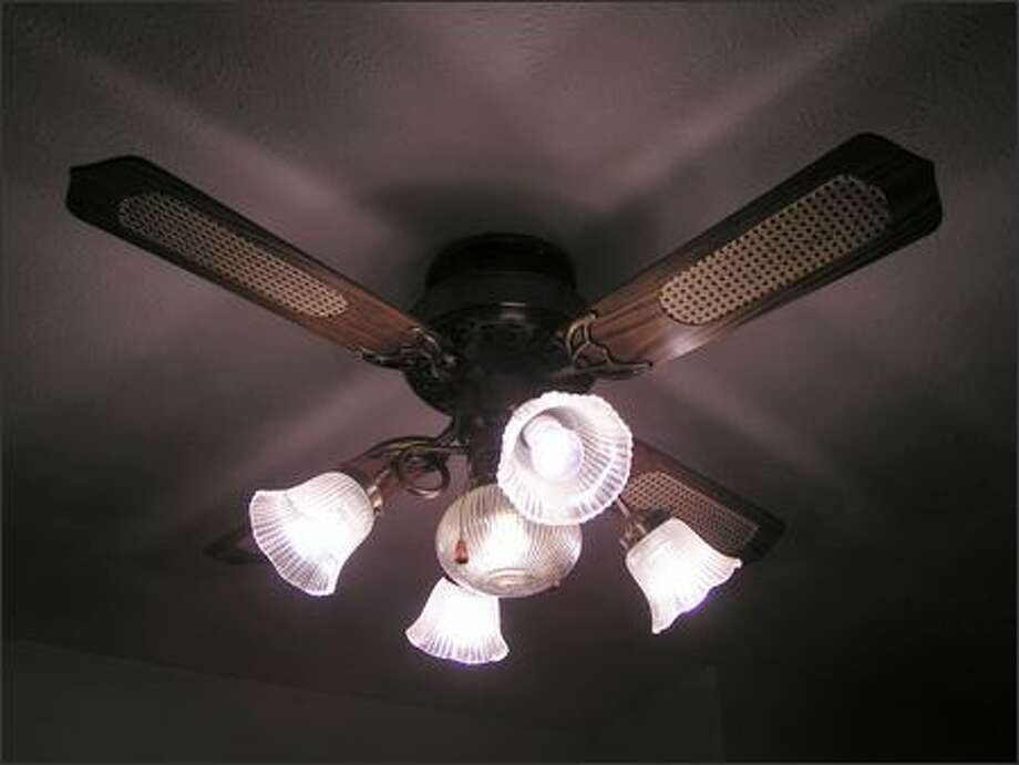 If you have a ceiling fan, reverse the motor to force warm air collected near the ceiling downward, says Kurt Osborn, a commercial sales specialist at a Lowe's outlet. Photo: /