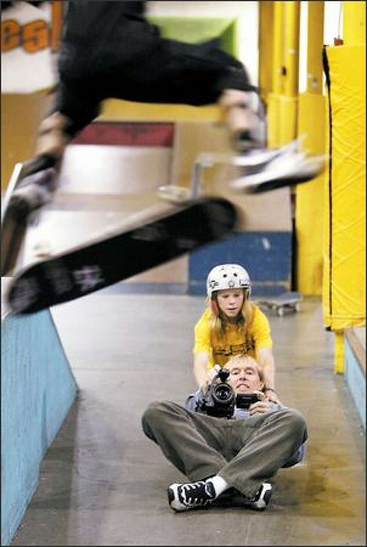 Boarder phenom Skyler Siljeg, 12, pushes Rod Parmenter so he can follow the action of Mitchie Brusco, 9, for the latest DVD in his