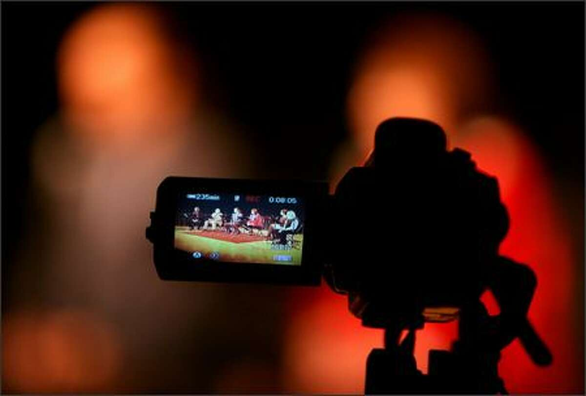 """The cast of """"City Play"""" performs at MOHAI, as seen through the viewfinder of this video camera."""