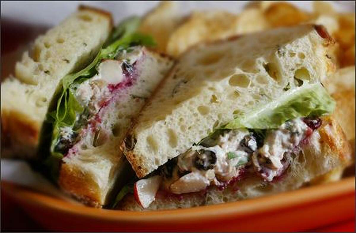 In this rendition of Turkey Salad Sandwich the filling includes walnuts, raisins and pears.
