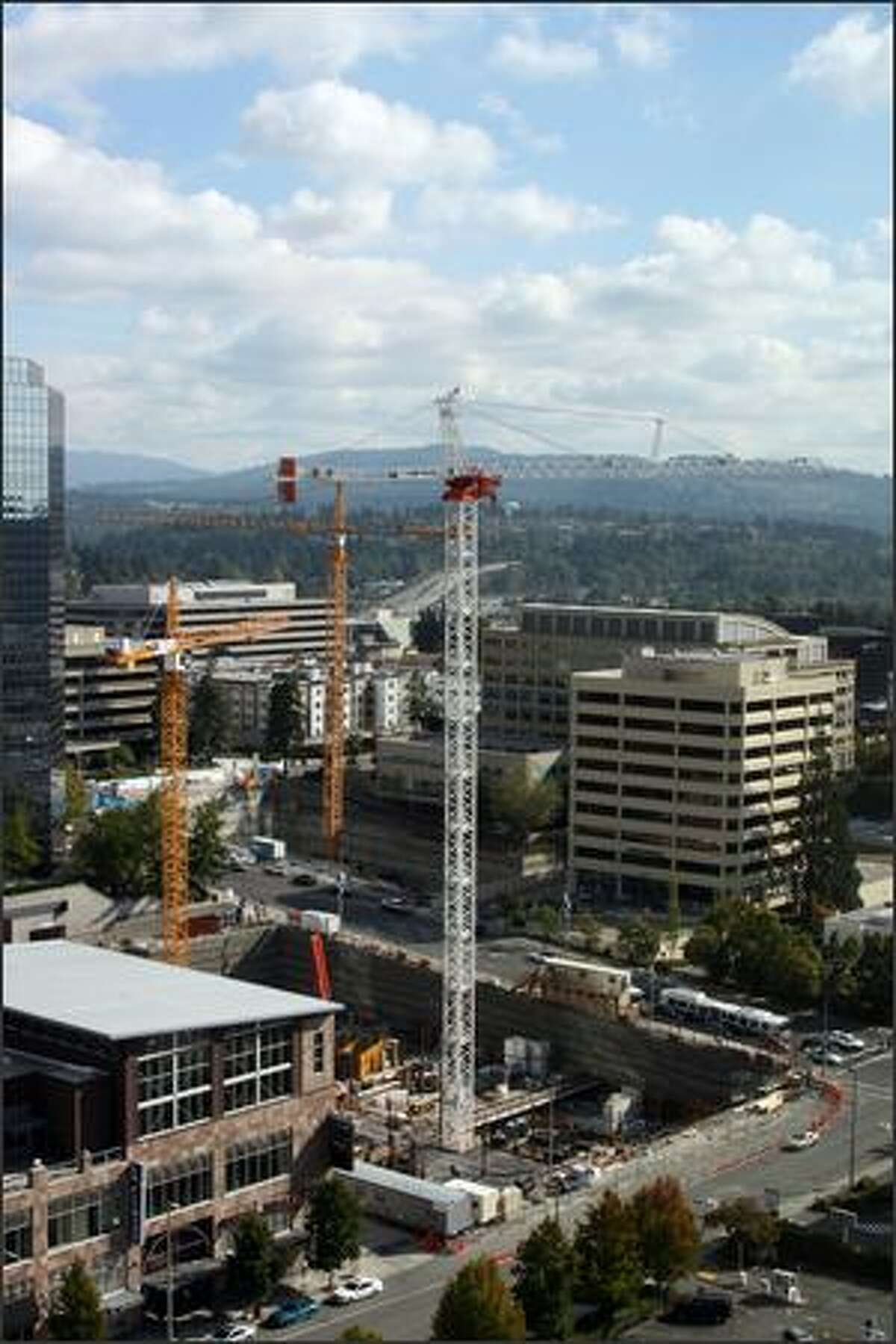 The crane in the middle of these three cranes is the one that toppled Nov. 16 in Bellevue. This photo is among those being used by investigators to determine what caused the accident.