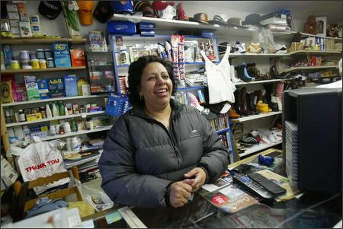"""Owner Maria Mejia is always ready with a smile at El Rincon Hispano. """"White Center is nice. I invite people from around the neighborhoods -- Ballard, downtown or Capitol Hill -- visit us and see what happens here,"""" she said."""
