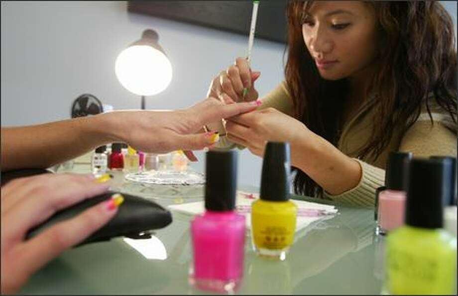 Tien Tran, owner of Couture Nails & Spa in the Central District, makes a point of creating a healthier environment for her workers and clients. The facility is spacious and well-ventilated, noxious solvents are disposed of quickly and Tran uses chamomile lotion rather than an aerosol to dry nails. Photo: Paul Joseph Brown/Seattle Post-Intelligencer