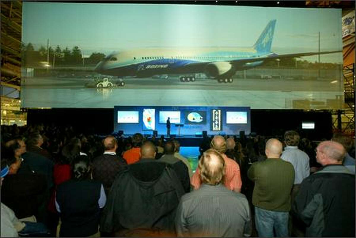 With the virtual display behind the stage, 787 program general manager Mike Bair explains what workers can expect.