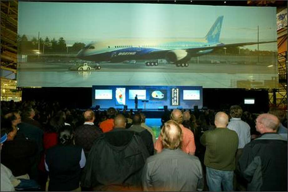 With the virtual display behind the stage, 787 program general manager Mike Bair explains what workers can expect. Photo: Grant M. Haller/Seattle Post-Intelligencer