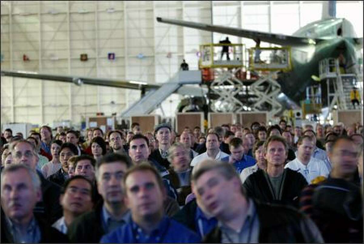 Boeing Co. employees in Everett watch computer simulations Wednesday of how the Dreamliner will come together.