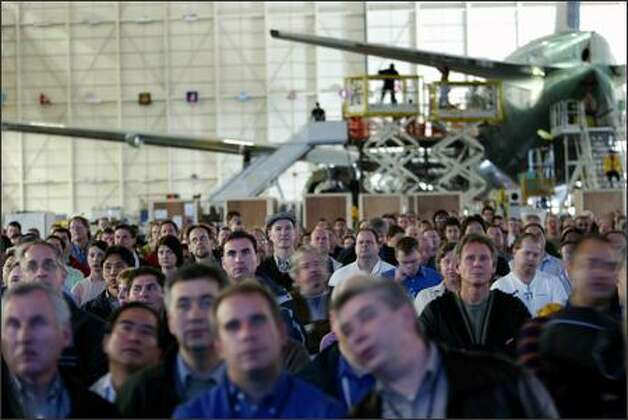 Boeing Co. employees in Everett watch computer simulations Wednesday of how the Dreamliner will come together. Photo: Grant M. Haller/Seattle Post-Intelligencer