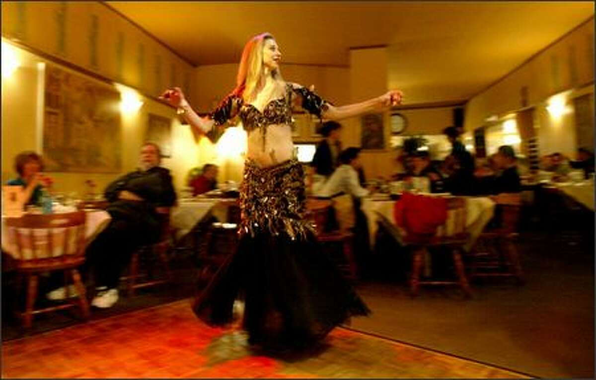 Nadira entertains the dinner crowd on a weekend night. Belly dancers and musicians perform at Caspian Grill in the University District on Friday and Saturday nights.