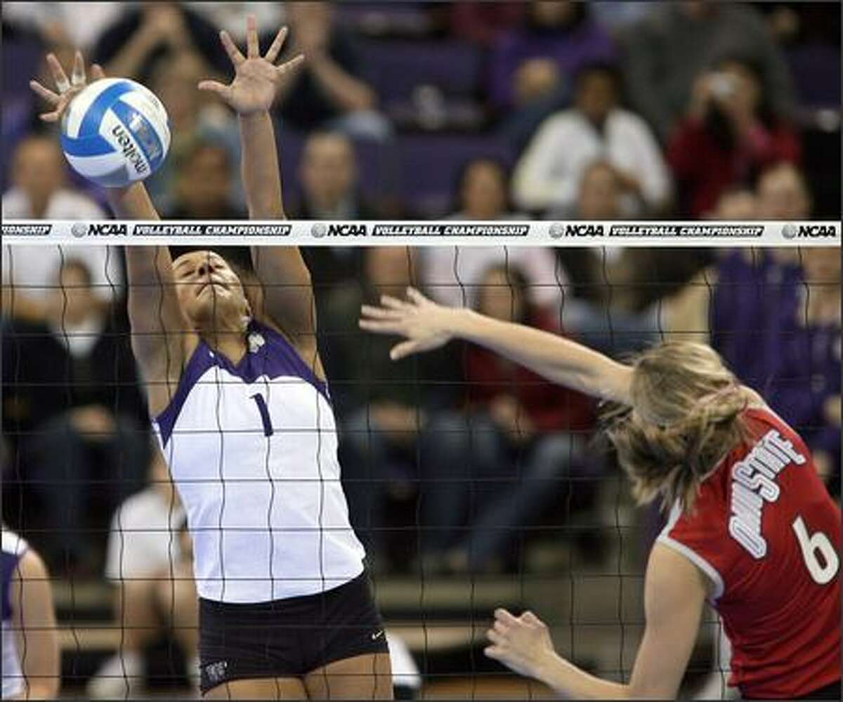 The Huskies' Stevie Mussie, who had 11 kills and 13 digs against Ohio State on Friday night, blocks Danielle Meyer.