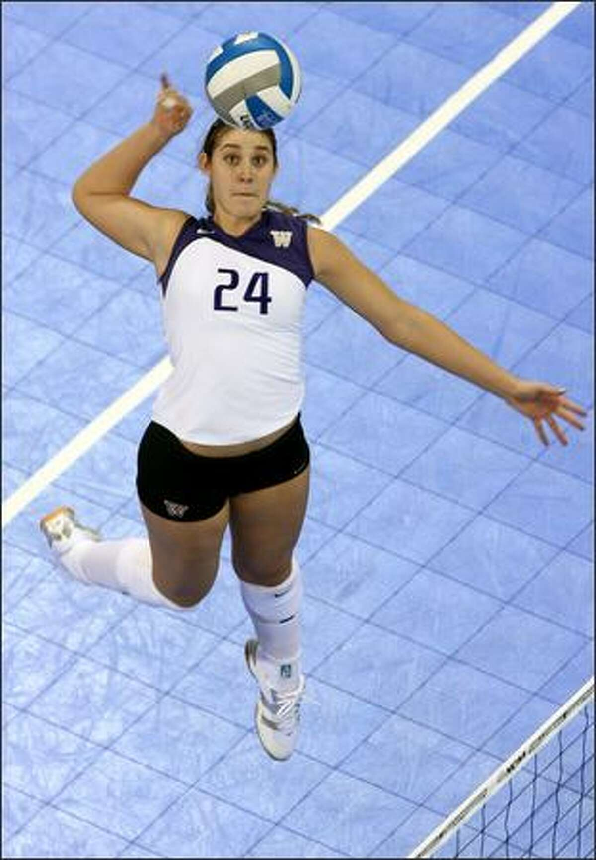 Jessica Swarbrick delivers one of her 10 kills against Ohio State at Edmundson Pavilion. She also had eight blocks.