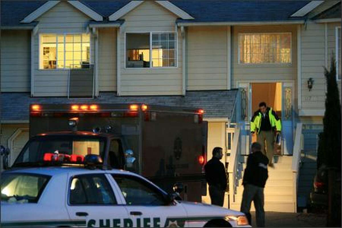 This is the Burien home where the victims were found. A fifth victim was in critical condition at Harborview MEdical Center.