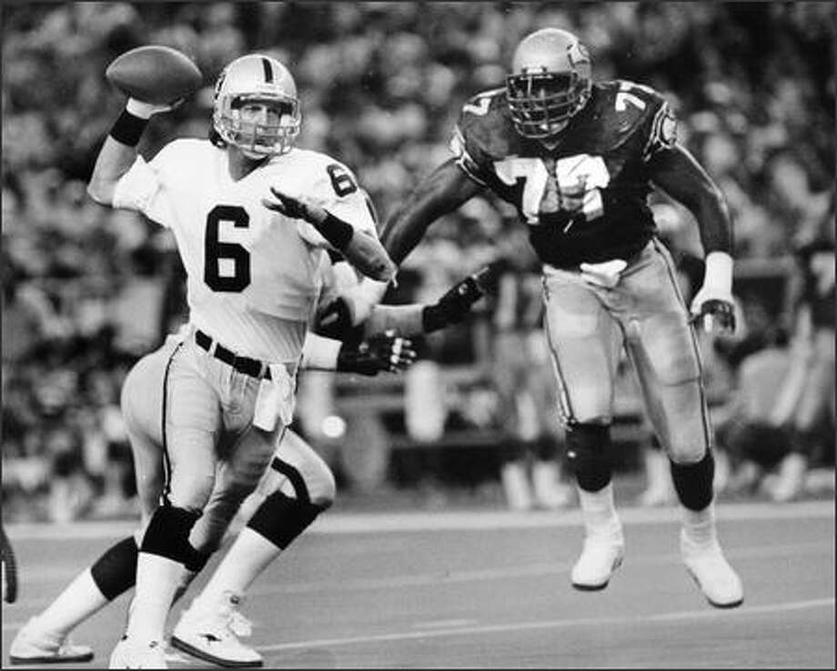 Then: Marc Wilson threw for 14,391 career yards in the NFL with the Raiders and Patriots. Photo: Grant M. Haller/Seattle Post-Intelligencer