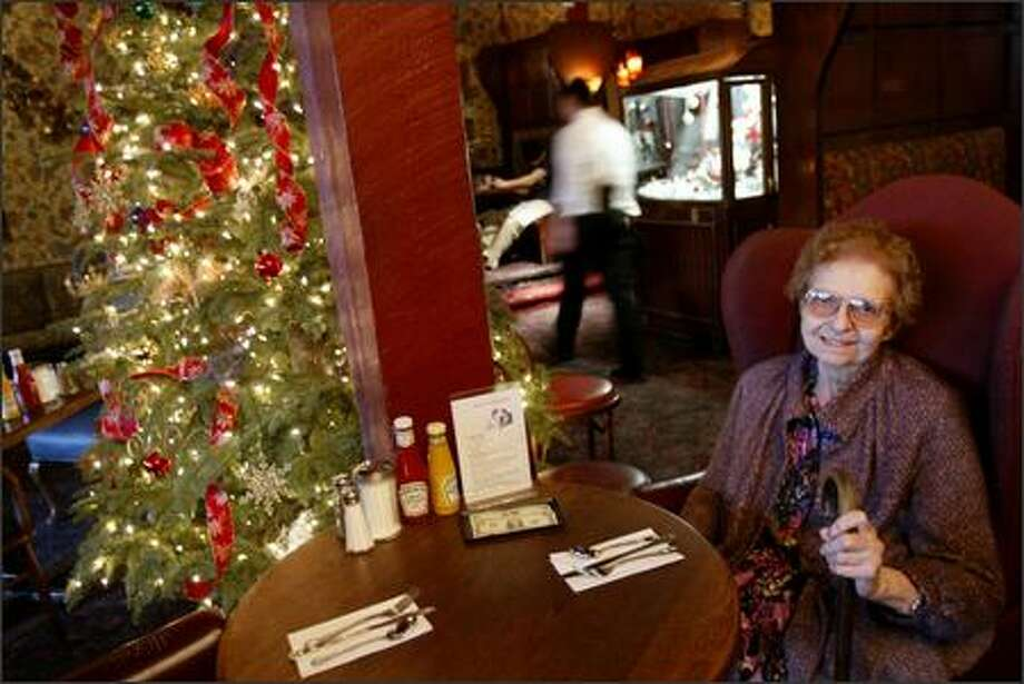 Juanita Wilson, 83, spends time Wednesday at Seattle restaurant Charlie's On Broadway, where she plans to be Christmas Day. Photo: Joshua Trujillo/Seattle Post-Intelligencer