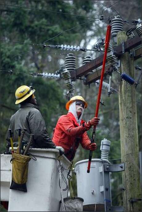 Seattle City Light lineworkers, pictured in a file photo. Photo: Karen Ducey/Seattle Post-Intelligencer
