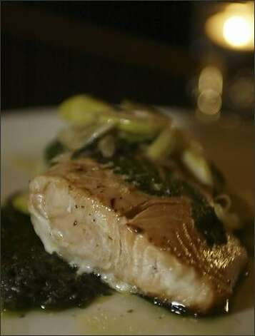King salmon with Nettle Salsa Verde is just one of the dishes that garnered Sitka & and Spruce the P-I's best restaurant of the year honor. Photo: JIM BRYANT/P-I