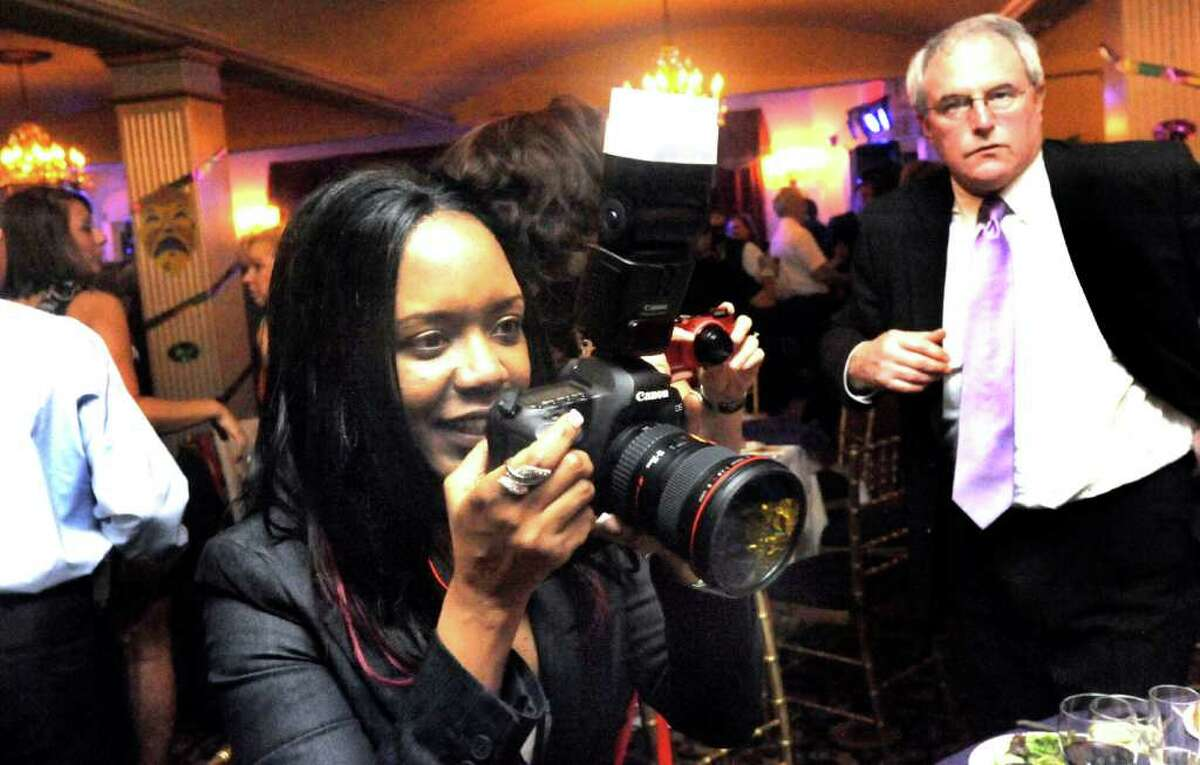Dee Harris photographs the Mardi Gras Gala, hosted by the Brookfield Chamber of Commerce. The event was held at The Fox Hill Inn in Brookfield, Saturday, March 19, 2011.
