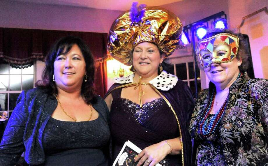 Rebecca Lollie, left, Linda Wagner, center, and Marie Miszewski conduct the activities during the Mardi Gras Gala, hosted by the Brookfield Chamber of Commerce. The event was held at The Fox Hill Inn in Brookfield, Saturday, March 19, 2011. Photo: Michael Duffy / The News-Times