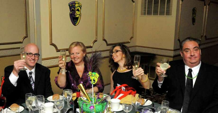 Guests join a toast during the Mardi Gras Gala, hosted by the Brookfield Chamber of Commerce. The event was held at The Fox Hill Inn in Brookfield, Saturday, March 19, 2011. Photo: Michael Duffy / The News-Times