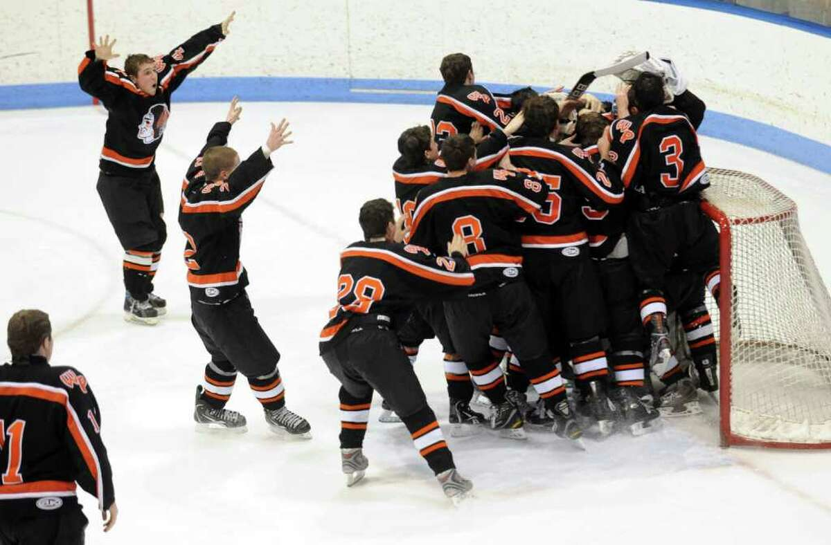 Watertown-Pomperaug celebrates their 4-0 victory over Staples-Weston-Shelton in the Division III state playoff game at Yale University's Ingalls Rink Saturday, Mar. 19, 2011.