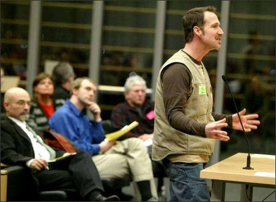 Joe Spallino, a lineman for Seattle City Light, testifies before the City Council Wednesday that he was sent home because of reluctance to pay employees on the night of the big storm. Photo: Joshua Trujillo/Seattle Post-Intelligencer