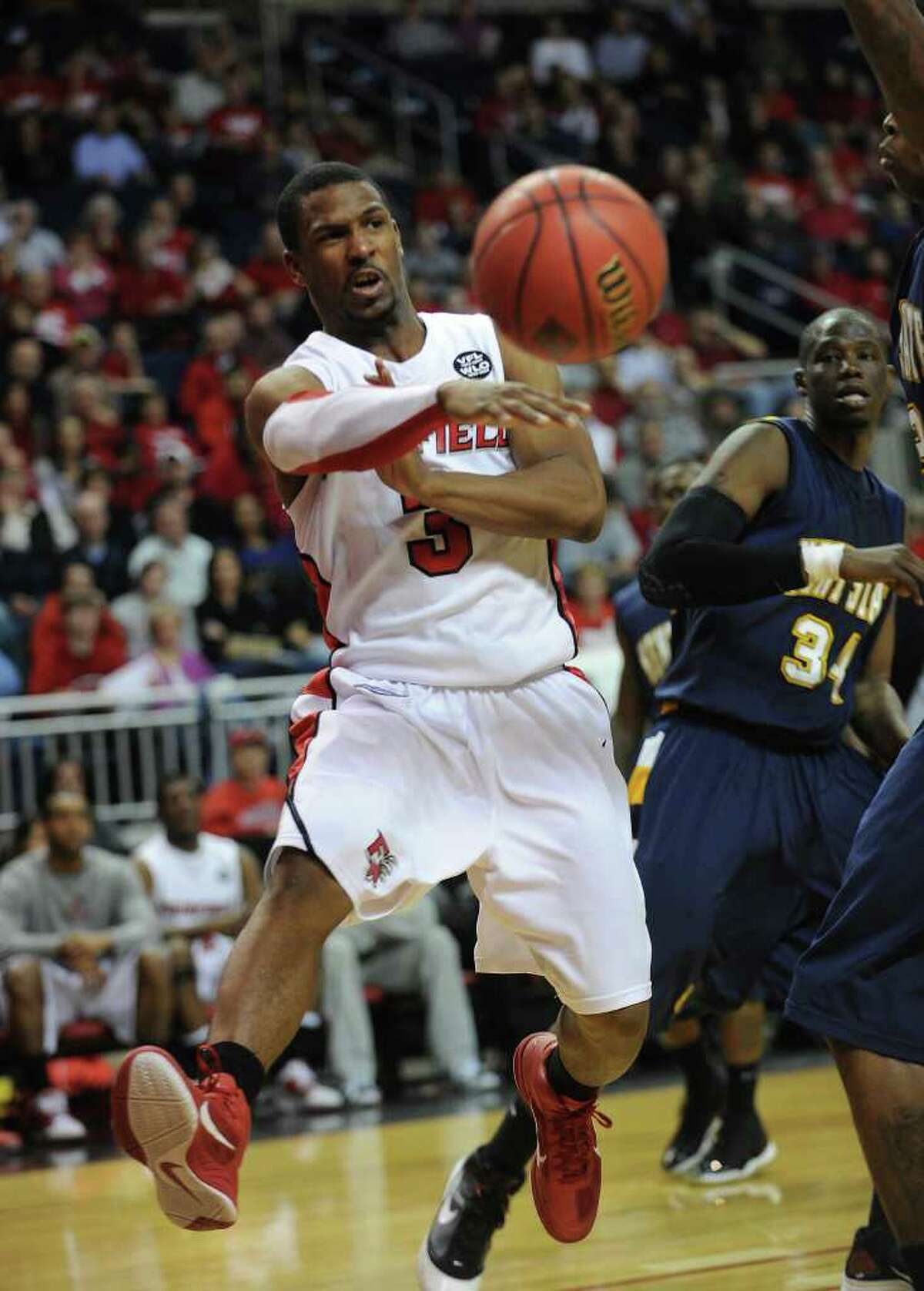Fairfield University's Derek Needham whips a baseline pass during the Stags' second round NIT matchup with Kent State at the Webster Bank Arena at Harbor Yard in Bridgeport on Sunday, March 20, 2011.