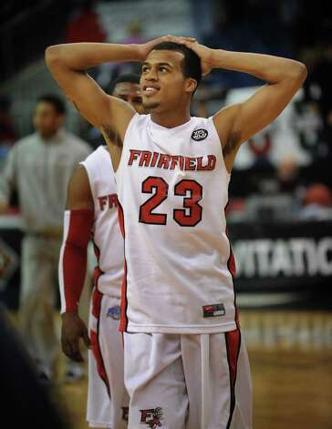 Fairfield University's Jamel Fields looks up at the scoreboard as he walks off the court following the Stags' loss to Kent State in the second round of the NIT at the Webster Bank Arena at Harbor Yard in Bridgeport on Sunday, March 20, 2011. Photo: Brian A. Pounds / Connecticut Post