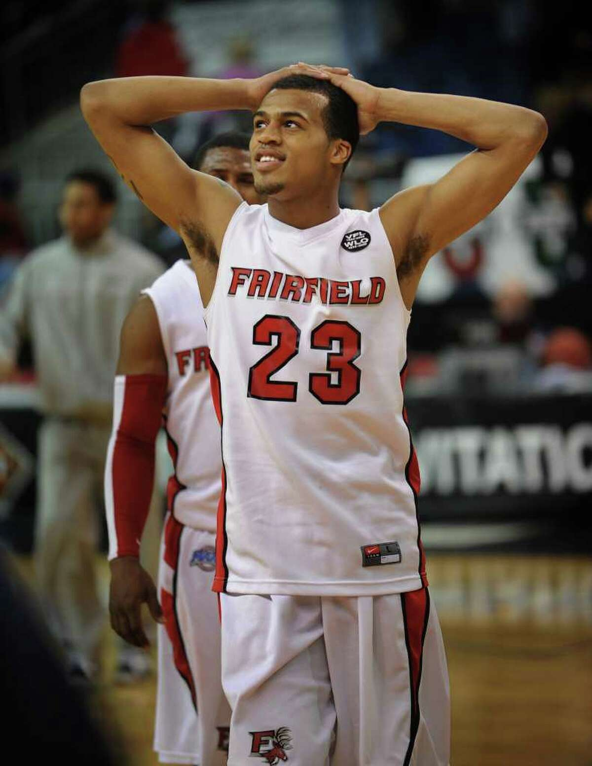 Fairfield University's Jamel Fields looks up at the scoreboard as he walks off the court following the Stags' loss to Kent State in the second round of the NIT at the Webster Bank Arena at Harbor Yard in Bridgeport on Sunday, March 20, 2011.