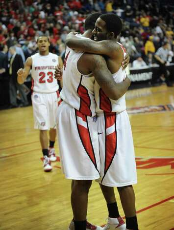 Fairfield University seniors Yorel Hawkins, left, and Lyndon Jordan embrace at the end of the Stags' second round NIT loss to Kent State at the Webster Bank Arena at Harbor Yard in Bridgeport on Sunday, March 20, 2011. Photo: Brian A. Pounds / Connecticut Post