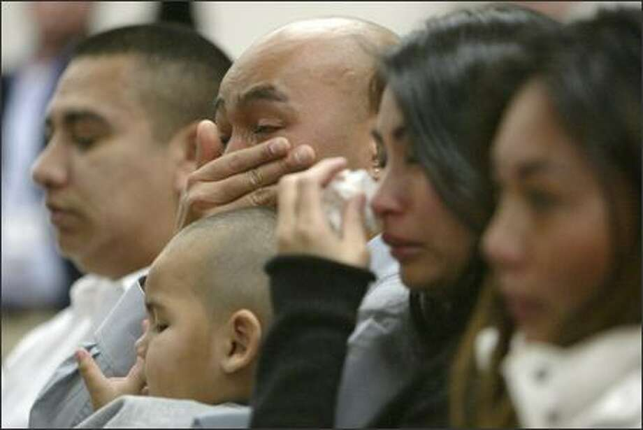 With hand to face, Rith Kok, brother of slain 17-year-old Samnang Kok, breaks down as he listens to Pierce County Superior Court Judge Stephanie Arend during the arraignment of Douglas Chanthabouly in Tacoma on Thursday. Chanthabouly is accused of killing Samnang Kok at Tacoma's Foss High School on Wednesday. Photo: Gilbert W. Arias/Seattle Post-Intelligencer