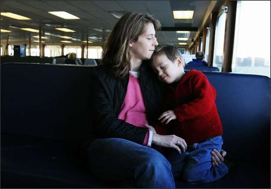 Mindy Leffler and Aidan ride the ferry to a naturopathic doctor on Whidbey Island. Leffler stays current on everything about her son's muscular disorder. Photo: Meryl Schenker/Seattle Post-Intelligencer