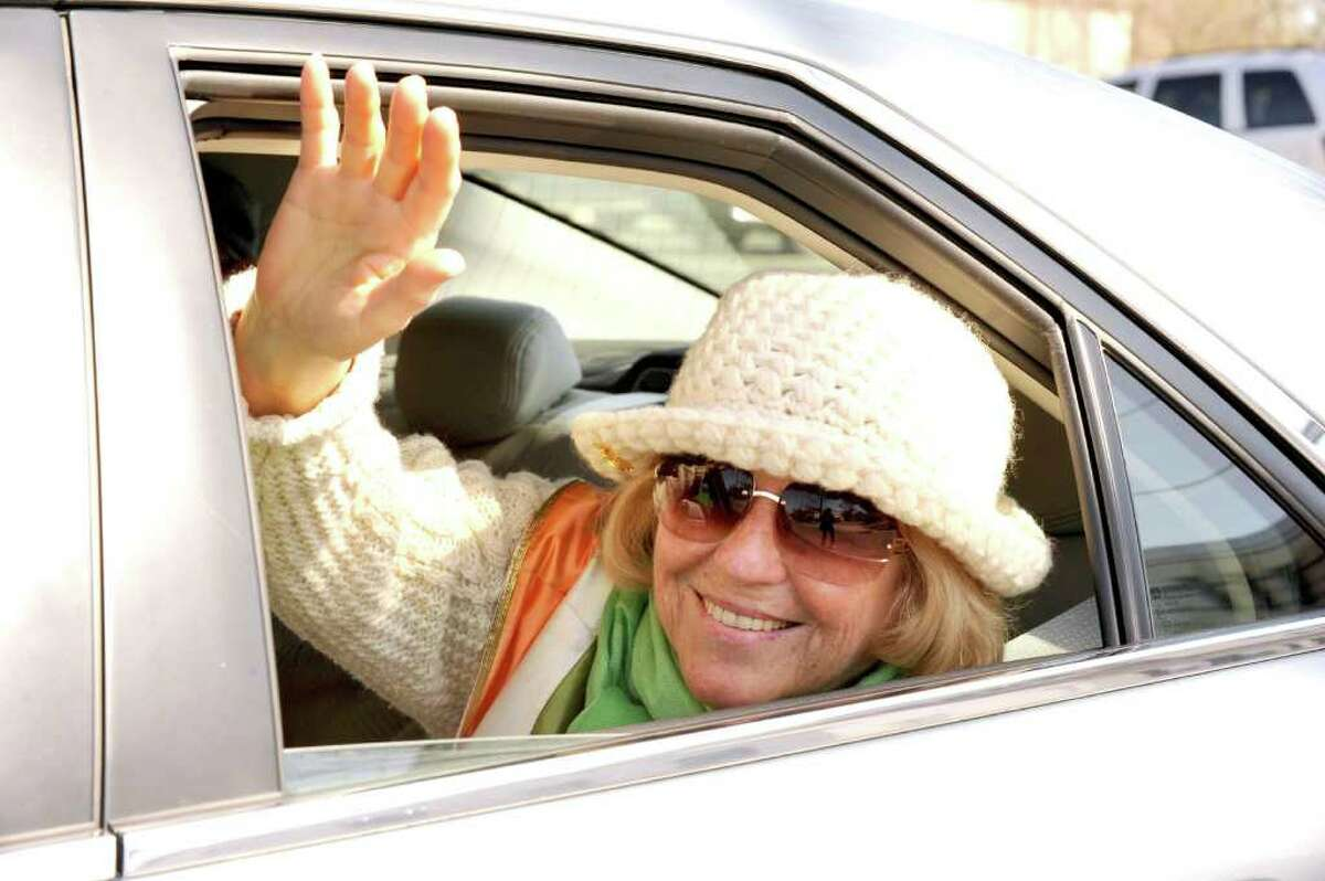 Peggy Cunningham, of New Fairfield, one of the Hibernians of the year, waves in the Ancient Order of the Hibernian's St. Patrick's Day parade in Danbury, Sunday, March 20, 2011.