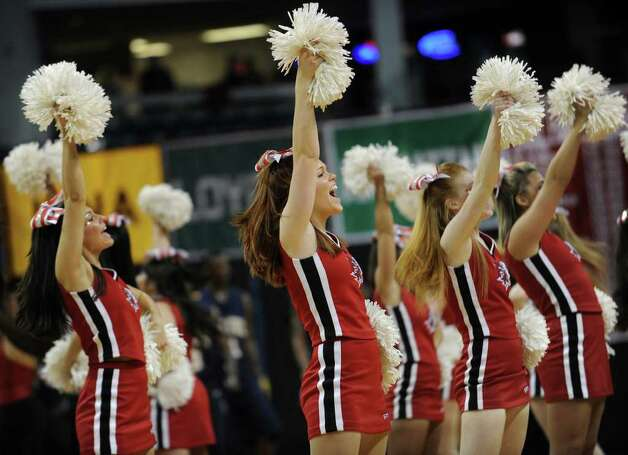 Fairfield University cheerleaders urge on the fans during the Stags' second round NIT matchup with Kent State at the Webster Bank Arena at Harbor Yard in Bridgeport on Sunday, March 20, 2011. Photo: Brian A. Pounds / Connecticut Post