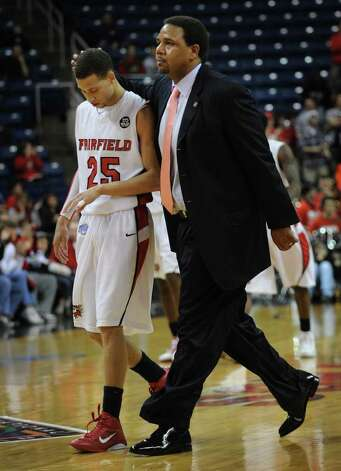 Fairfield University head coach Ed Cooley consoles his player Colin Nickerson as the two walk off the court during the Stags' second round NIT matchup with Kent State at the Webster Bank Arena at Harbor Yard in Bridgeport on Sunday, March 20, 2011. Photo: Brian A. Pounds / Connecticut Post
