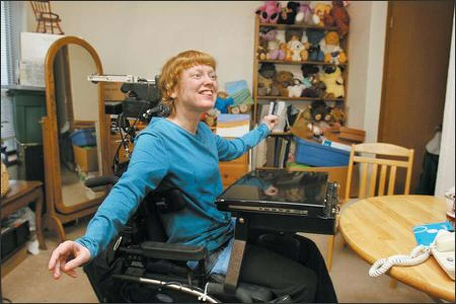 Kristin Rytter is believed to be the first University of Washington student with cerebral palsy to earn a doctoral degree. Although she cannot speak and cannot use her hands or feet, she has found ways to communicate, at times spending 10 hours a day researching and writing. She is already sharing her research with others outside the UW. Photo: Meryl Schenker/Seattle Post-Intelligencer