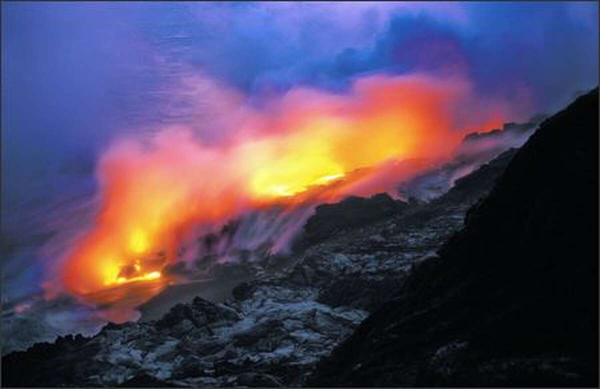 The tongue of a lava flow meets the sea.