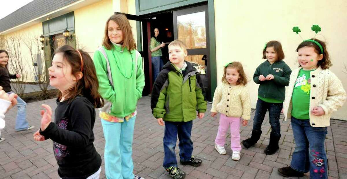 Childern, including Ally Eecchia, 8, of Danbury, left center, Aidan Hearty, 4, of New Fairfield, center, Maura Witkowski, 2, right center, with her sister, Catie Witkowski, 5, of Southbury, and Sydney O'Connell, 4, right, also of Southbury, play at the Irish Cultural Center after the Ancient Order of the Hibernian's St. Patrick's Day parade in Danbury, Sunday, March 20, 2011.